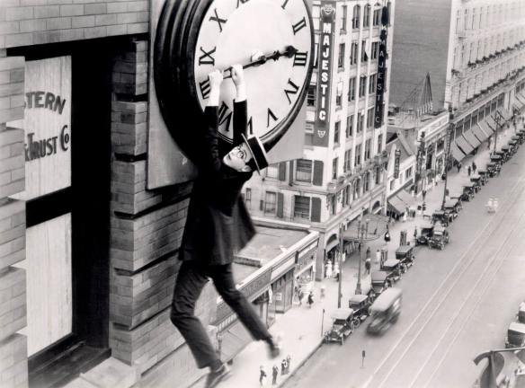 Harold Lloyd hangs from the clockface in Safety Last